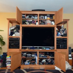 Unorganized & Cluttered Home Entertainment Center - Before Photo